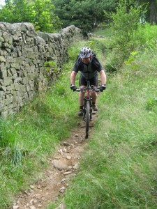 Kev on the singletrack descent to Hayfield campsite.
