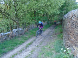 Jeanette on the Pennine Bridleway climb from the Sett Valley.