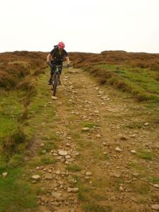 Brian on the loose rocks of the Wimble Holme Hill descent.