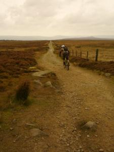 Brian descending from Stanage Pole under the red sky due to blown Saharan sand.