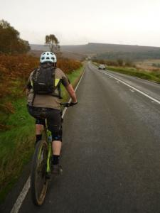 Brian on the long A6187 climb from Hathersage.
