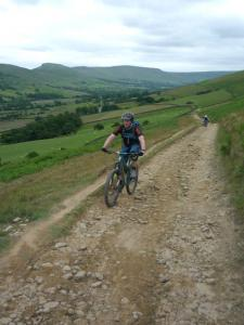 Alistair climbing out of Edale Valley.
