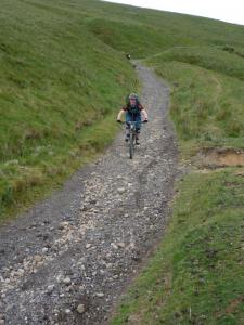 Alistair descending Chapel Gate into Edale Valley.