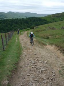 Anne climbing the loose, rocky track from Jaggers Clough to Hope Cross.