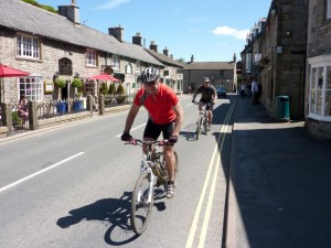 Steve and Peter riding through Castleton.