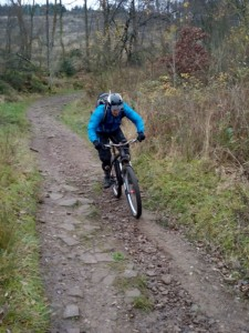 Matt descending the cycle trail in Macc Forest.