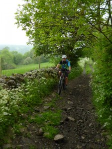 Alex climbing Long Lane from Millers Dale.