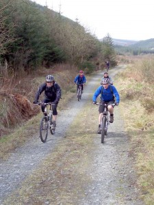 Andy, Jim, Annwen and Shane climb through the woods.