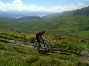 Graham on the Braich traverse with views over the Mawddach Estuary.