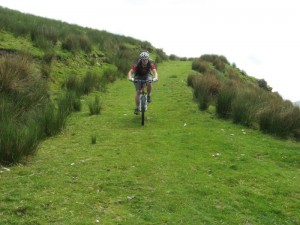 Peter descending the grassy steep.