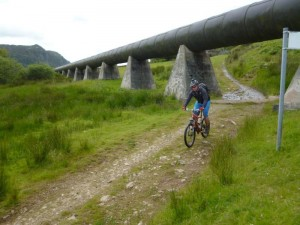 Chris going under the Llyn Cowlyd pipeline.