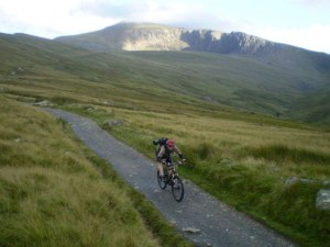 Mark descending the Llanberis Trail with Snowdon's summit visible behind.