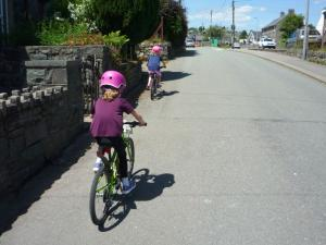 Elisabeth and Anna climbing through Trawsfynydd village.