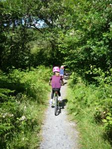 Elisabeth and Anna following the woodland singletrack back to the Trawsfynydd Lake Centre.