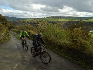 Rob and Dan on the Charlestown climb with a great view over Calderdale.