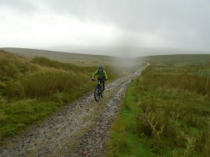 Brian climbing to the Churn Milk Hole junction below Pen-y-ghent.
