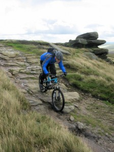 Lee descending the rocks on Black Moor.