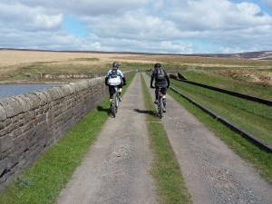 Paul and Laurence crossing the lower Gorple Reservoir.