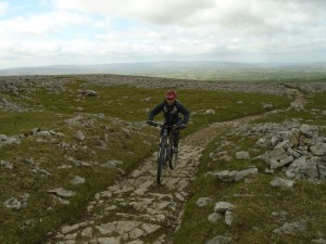 Graham climbing the rocks of Twisleton Scar End.