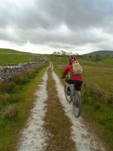 Graham climbing to the B6479 junction on the Pennine Bridleway.