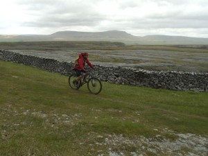 Graham riding past Moughton Scars.