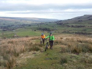 Brian and Jan pushing through the field, on the Pennine Way, from Gaudy House.