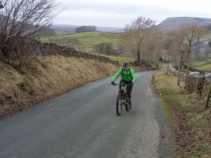 Brian climbing Bellow Hill from Hardraw.
