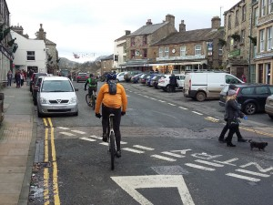 Riding through the centre of Hawes in the Yorkshire Dales.