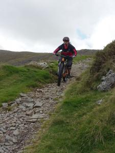 John on the fast and rocky Bwlch y Rhiwgyr descent.