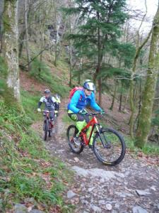 Mat and Gavin climbing the Parc a reid singletrack at the start of the Gwydir Mawr trail.