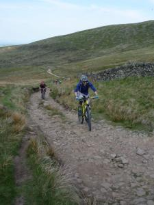 Chris with a face of pain climbing to Edale Cross.