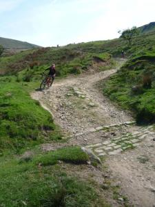 Graham and Mark flying down the Coldwell Clough descent.
