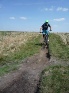 Stuart descending the Rushup Edge singletrack.