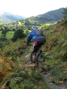 Ritchie on the scree singletrack descent to Llangynog.