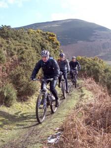 Jim, Ken and Steve on muddy singletrack from Moel Arthur.
