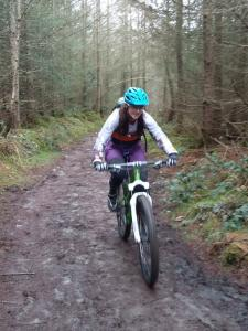 Emma following the Nercwys Forest cycle route.