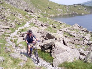 Paul riding round Small Water, halfway up the Nan Bield Pass.
