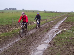 Sabine and Paul on the muddy track through Haddon Fields.