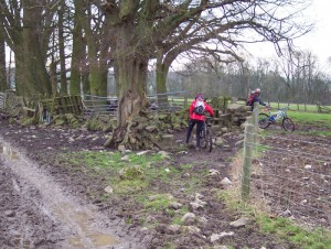 Sabine and Paul going through the muddy Haddon Fields gate.