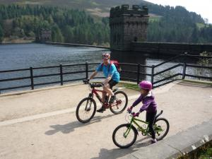 Grandad and Elisabeth at the top of the Derwent Dam.