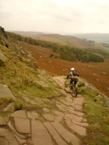 Brian descending the rocks of Stanage Edge in the Peak District.