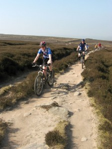 Sabine and Ches on the gritstone trail to the shooting cabin junction on Middle Moor.