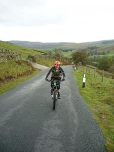 Brain on the long Stang Lane climb out of Arkengarthdale.