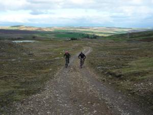 Brian and Karl climbing through the Hind Rake earthworks.