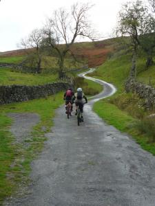 Brian and Karl starting the evil climb from Healaugh, in Swaledale.