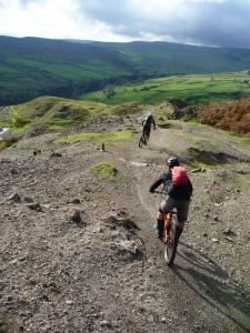 Karl and Brian descending through Fell End quarry into Arkengarthdale in the Yorkshire Dales.