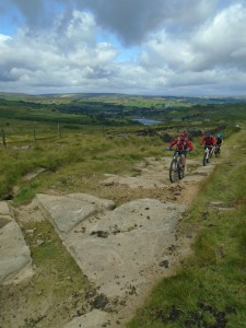 Climbing the rock slabs of the Bronte Way.