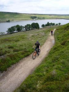 James and Jeff climbing from Widdop Reservoir on the Pennine Bridleway.