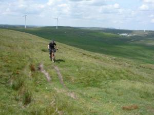 James riding to the summit of Freeholds Top.